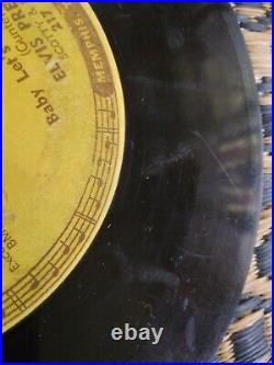 1955 Sun 217 45 record. Elvis Presley, Baby, let's Play House. Plays, punch marks
